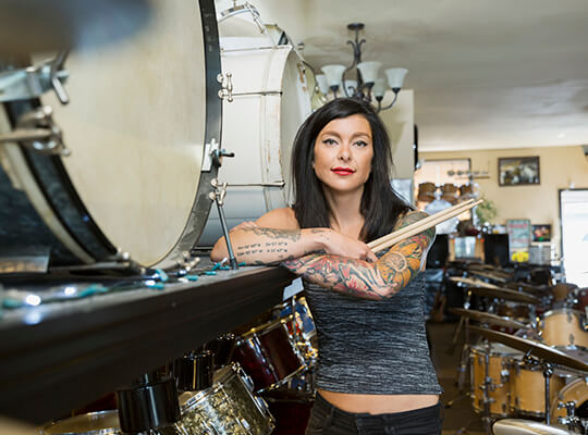 Woman in a drum shop.