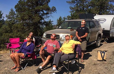 People gather to watch the solar eclipse in Malheur National Forest, Oregon