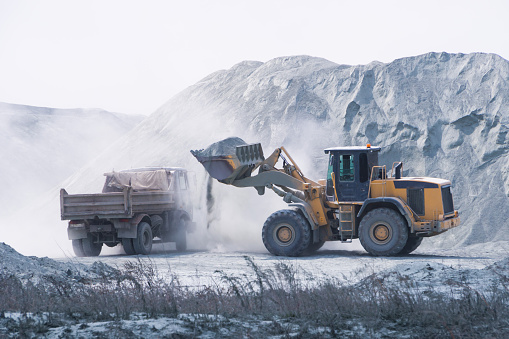 A front-end loader removes volcanic ash in Washington's Columbia Basin following the 1980 eruption of Mount St. Helens