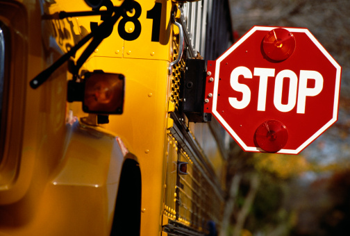 School bus with stop sign extended